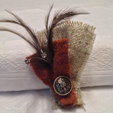 Tweed and felted wool with vintage feather and button trim